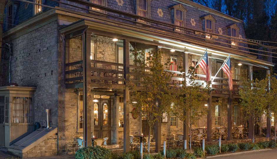 The exterior of the newly renovated inn at dusk