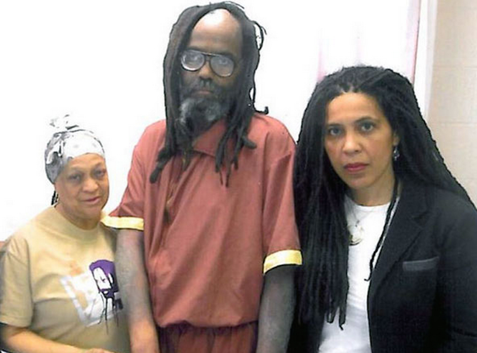 Mumia Abu-Jamal (center) with MOVE's Pam Africa (left) and Mumia supporter Johanna Fernandez (right), via Facebook