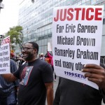 NEW YORK CITY - AUGUST 23 2014: Thousands rallied in Staten Island demanding justice & accountability in the deaths of Eric Garner, Michael Brown & other victims of alleged police brutality a katz / Shutterstock.com