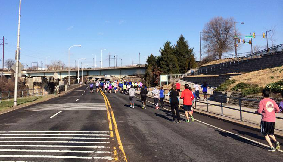 Runners along West River Drive | Photo via Facebook