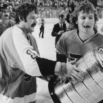 Philadelphia Flyers Bernie Parent, left, and Bobby Clarke, carry the Stanley Cup off the ice in Buffalo, May 27, 1975 after winning over the Buffalo Sabres. Score of the final game was 2-0.