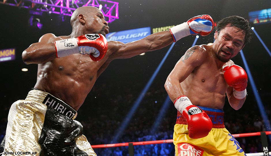 In this May 2, 2015, photo, Floyd Mayweather Jr., left, hits Manny Pacquiao, from the Philippines, during their welterweight title fight in Las Vegas.
