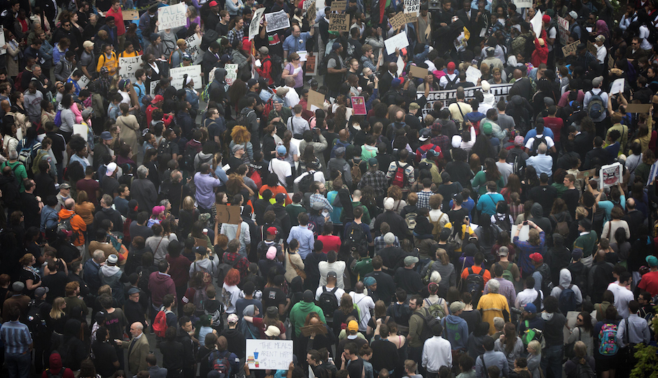 Protesters demonstrate outside City Hall in Philadelphia on Thursday, April 30, 2015. The event in Philadelphia follows days of unrest in Baltimore amid Freddie Gray's police-custody death. | Photo by Matt Rourke/AP