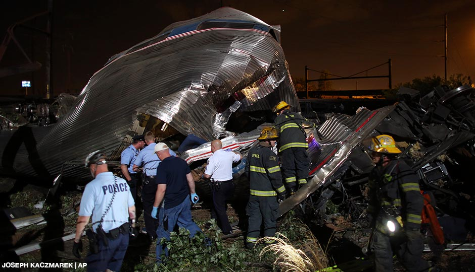 Emergency personnel work the scene of a train wreck, Tuesday, May 12, 2015, in Philadelphia. An Amtrak train headed to New York City derailed and crashed in Philadelphia.