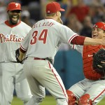 May 29, 2010; Miami, FL, USA; Philadelphia Phillies starting pitcher Roy Halladay (34) celebrates with catcher Carlos Ruiz (51) and Ryan Howard (6) after pitching a perfect game against the Florida Marlins at Sun Life Stadium. Philadelphia Phillies defeated the Marlins 1-0 Mandatory Credit: Steve Mitchell-USA TODAY Sports