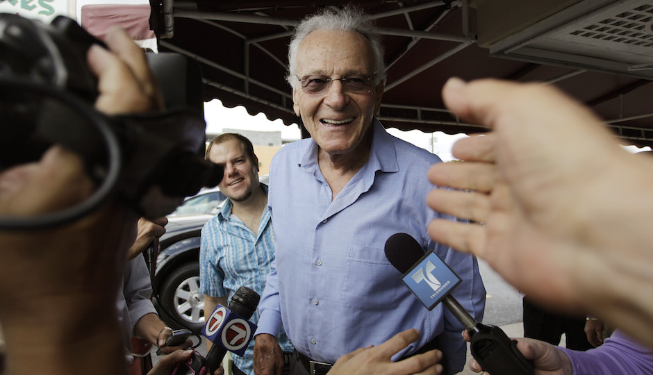 Supporters reach out to touch Norman Braman Tuesday, March 15, 2011 before he ate lunch at a Cuban cafe in Miami.  | AP