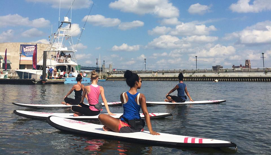 Outdoor Yoga in Philadelphia | Stand up paddleboard yoga at Spruce Street Harbor Park