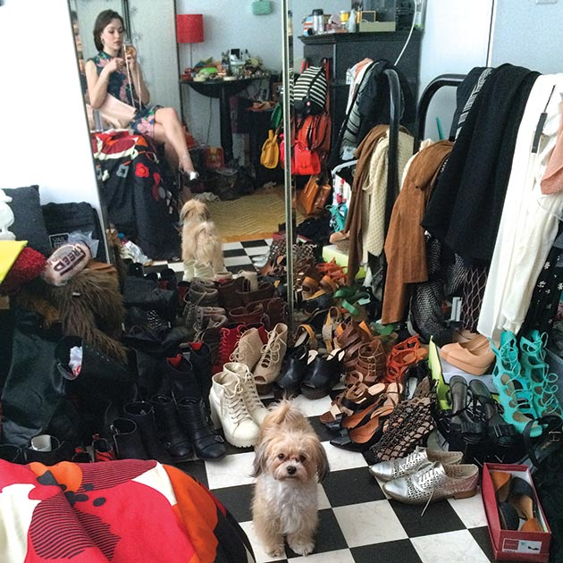 """Pennsylvania Ballet dancer Kelsey Ivana Hellebuyck with her Havanese pup at home, choosing shoes to wear for a night out, March 24, 2015. """"#photoBOMBbyCOCO"""""""