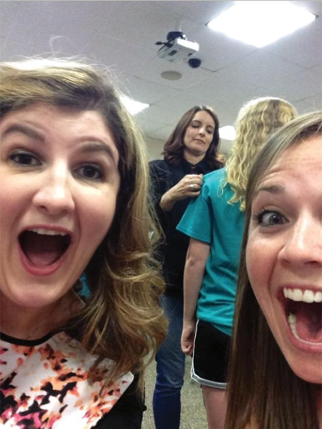 Reader Selfie: Lauren Sammartino and Robyn Cartlidge with Tina Fey (sort of) as she autographs a fan t-shirt at the Upper Darby Performing Arts Center, August 16, 2014.