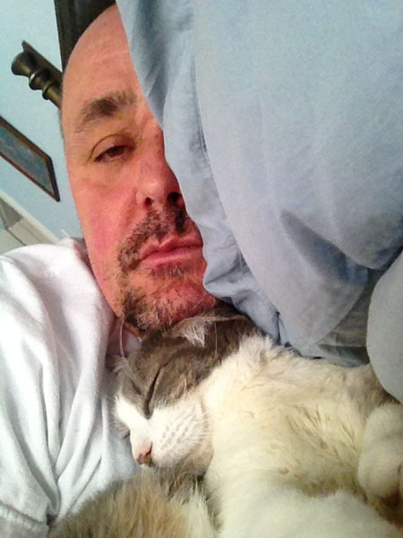 NOORD's Joncarl Lachman napping with his cat Vincent.