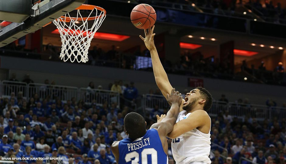 Mar 19, 2015; Louisville, KY, USA; Kentucky Wildcats forward Karl-Anthony Towns (12) shoots the ball against Hampton Pirates forward Jervon Pressley (30) during the second half in the second round of the 2015 NCAA Tournament at KFC Yum! Center. Kentucky wins 79-56.