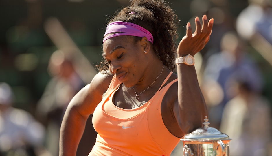 Serena Williams (USA) poses with the trophy after her match against Lucie Safarova (CZE) on day 14 of the 2015 French Open at Roland Garros. | Susan Mullane-USA TODAY Sports
