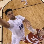 Duke Blue Devils center Jahlil Okafor (15) shoots the ball against Wisconsin Badgers forward Frank Kaminsky (44) during the first half in the 2015 NCAA Men's Division I Championship game at Lucas Oil Stadium on April 6, 2015, in Indianapolis.