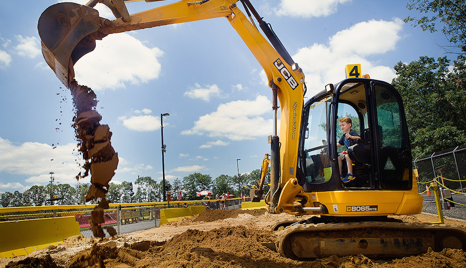 Kid playing in a TK at Diggerland. | Photo by Daryl Peveto