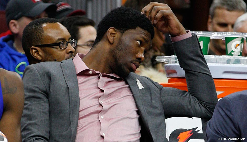 Joel Embiid looks on from the sidelines during the January 7, 2015 game between the Milwaukee Bucks and the Philadelphia 76ers at the Wells Fargo Center.