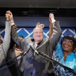 Kenney and supporters on election night. Photograph by Matt Slocum, Associated Press
