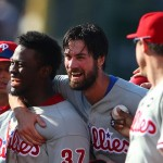 Philadelphia Phillies starting pitcher Cole Hamels and center fielder Odubel Herrera celebrate after defeating the Chicago Cubs 5-0 at Wrigley Field. Photo | Caylor Arnold-USA TODAY Sports