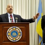 Philadelphia District Attorney Seth Williams, center, accompanied by investigator Frank Fina, speaks during a news conference Monday, Jan. 27, 2014, in Philadelphia.
