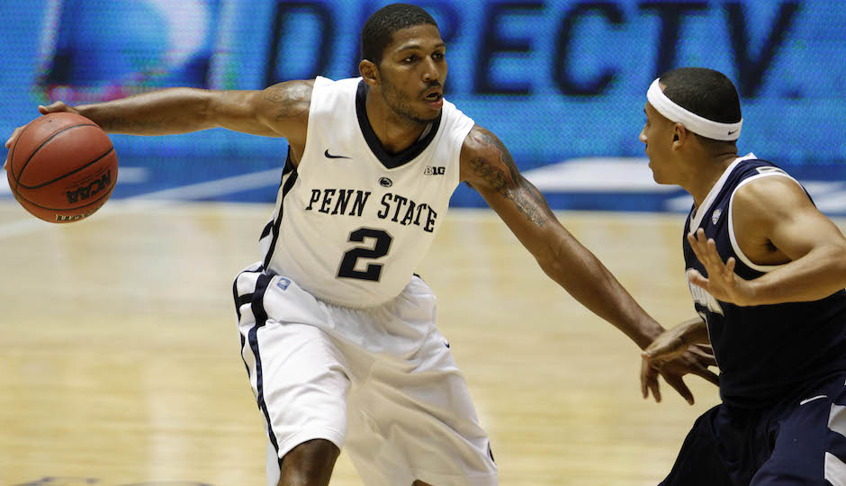 Penn State's DJ Newbill, left, drives against Akron's Alex Abreu during a NCAA college basketball game in Bayamon, Puerto Rico, Sunday, Nov. 18, 2012. (AP Photo/Ricardo Arduengo)