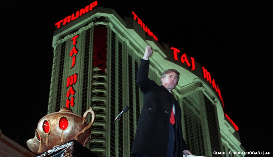 Donald Trump ascends the stairs with his fist raised after the opening of the Trump Taj Mahal Casino Resort in Atlantic City, N.J. on April 5, 1990.