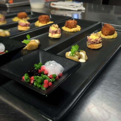 A Summer Salad in the form of frozen dots; Potato Salad in the form of sautéed potato gnocchi;  A Burger in the form of beef tartare with house-made mustard, pickled ramps, and seived egg yolks;  Croquette of Mole Short Rib atop a humita of sweet summer corn, and smoky bbq