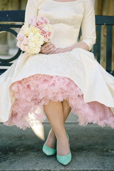 We love the pretty charm of a vintage wedding dress. Photo via Pinterest.