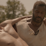 Benjamin Jones (Jeremiah Trotter) carries Lewis (John Wooten) in The North Star.
