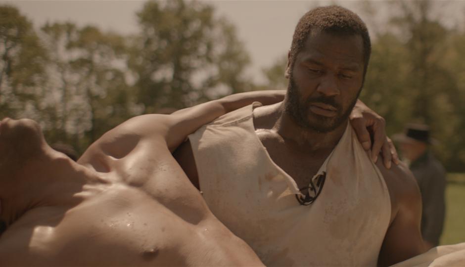 Benjamin Jones (Jeremiah Trotter) carries Lewis (John Wooten) in The North Star.