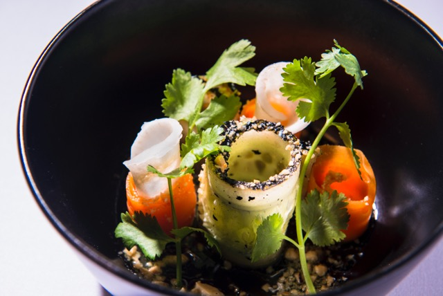 This is a salad of charred cucumber, carrot, pickled daikon and cashews, dressed in jalapeño vinaigrette and sriracha honey.