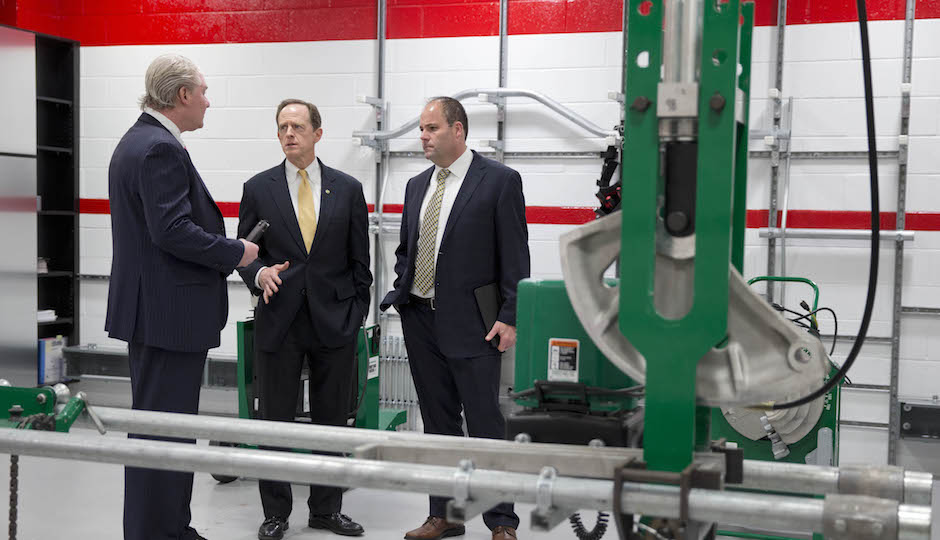 John Dougherty (left) takes U.S. Sen. Pat  Toomey on a tour of the electrician union's apprentice training facility in February 2014. | Photo by Matt Rourke/AP
