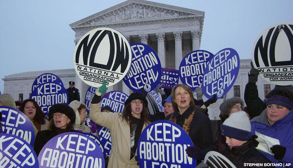Patricia Ireland, president of National Organization for Women (NOW), third from right, demonstrates with other NOW participants in favor of the Roe vs. Wade decision during the candlelight vigil on the steps of the Supreme Court in Washington D.C. in 2000.
