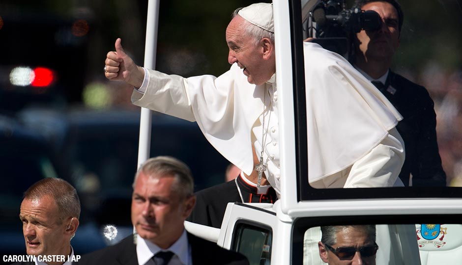 Pope Francis give the thumbs-up from the popemobile during a parade around the Ellipse near the White House in Washington, Wednesday, Sept. 23, 2015.