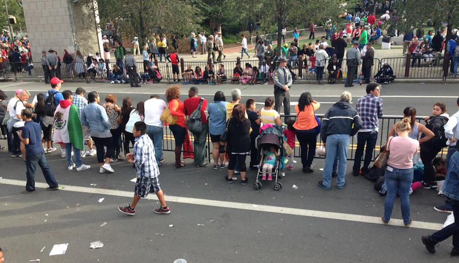 The crowd thins out after Pope Francis drives by. | Photo by Holly Otterbein