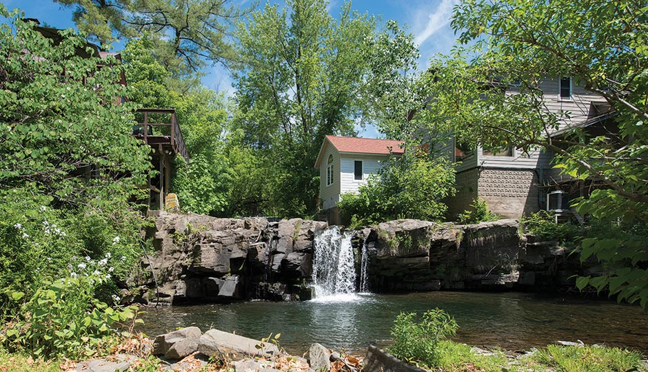 A waterfall near Woodstock's main street. Photograph by Cindy Halliburton