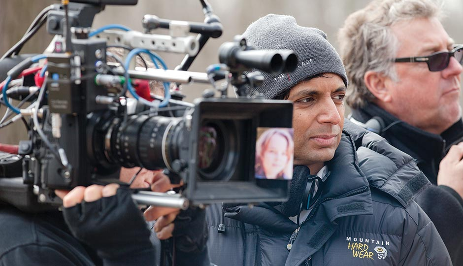 M. Night Shyamalan on the set of The Visit. Photograph by John Baer/Universal Pictures