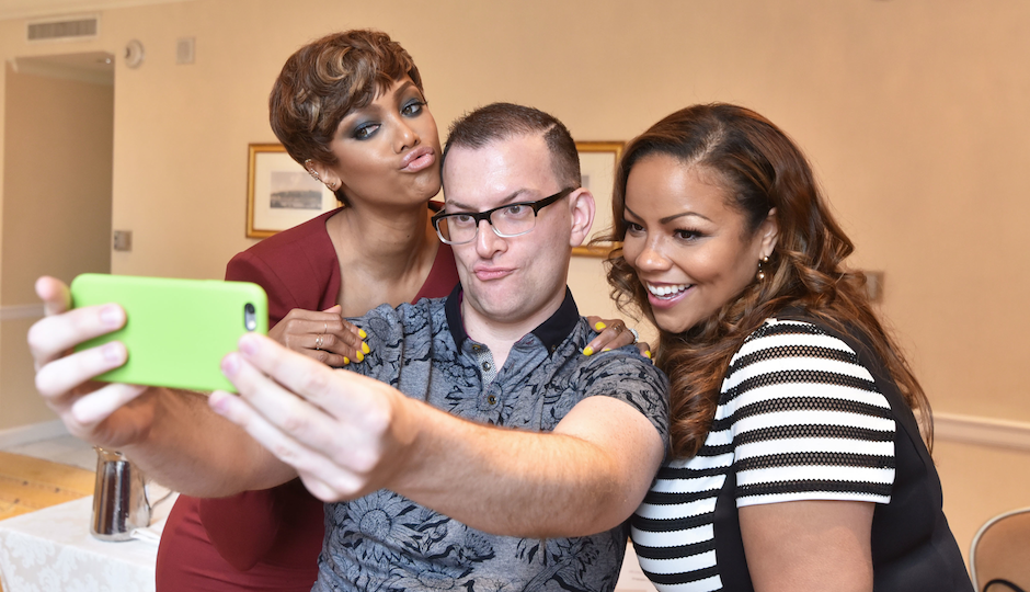 Tyra Banks and Lauren Makk trying to teach me how to take a selfie. Picture by HughE Dillon.
