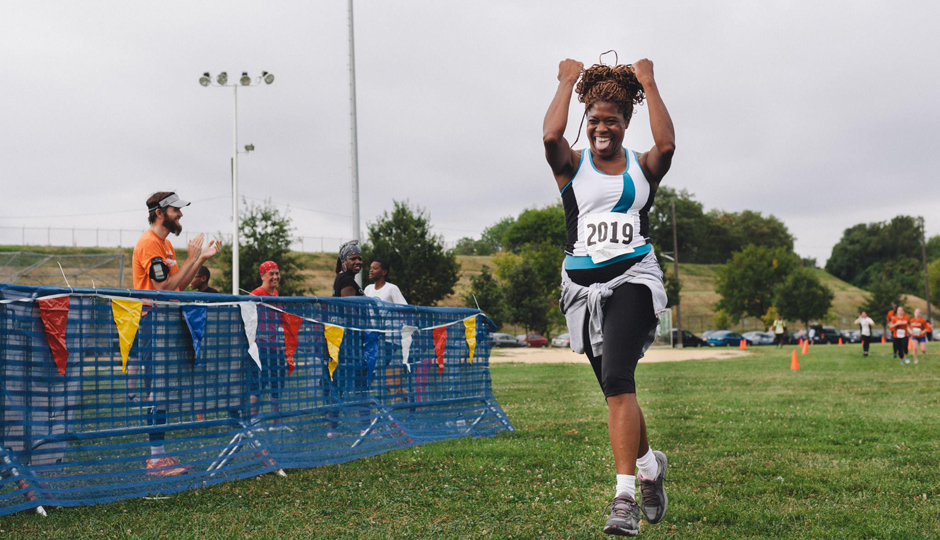 A happy finisher at the Boxers' Trail 5K | Photo by Charles Bouril