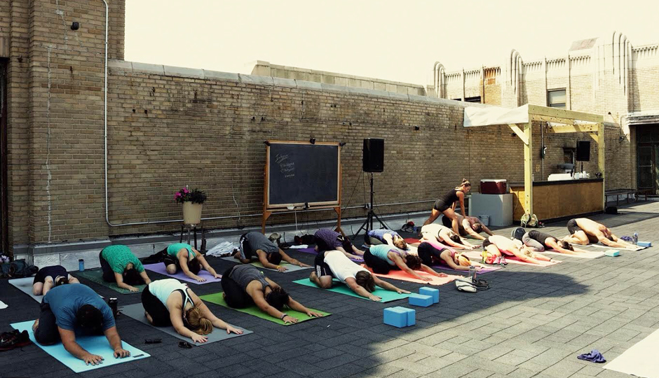 Rooftop yoga at Le Bok Fin | Photo by Josh Thornton