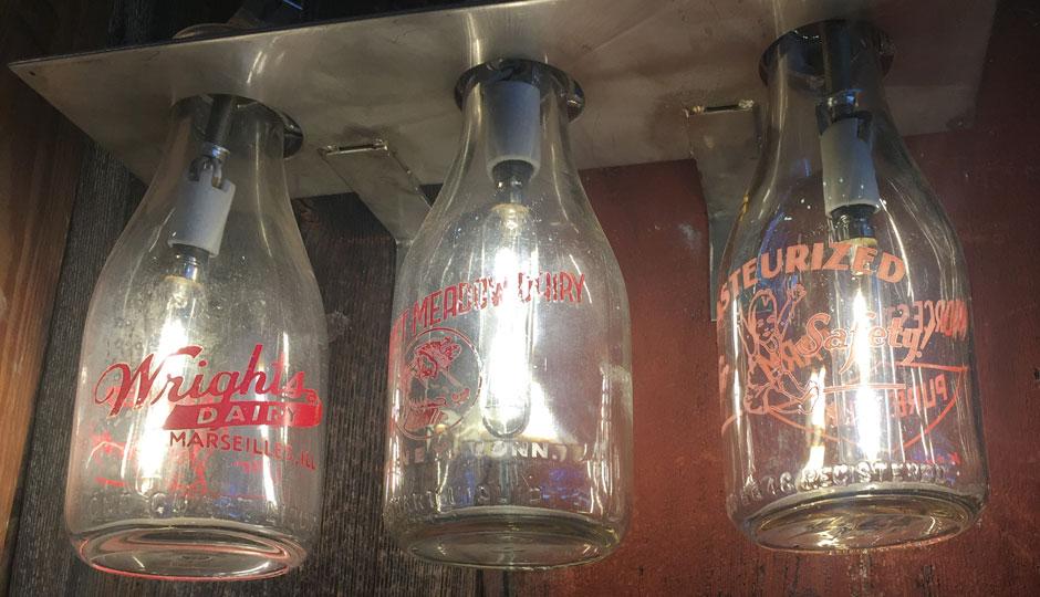 Glass milk bottles double as lighting at Meltkraft.