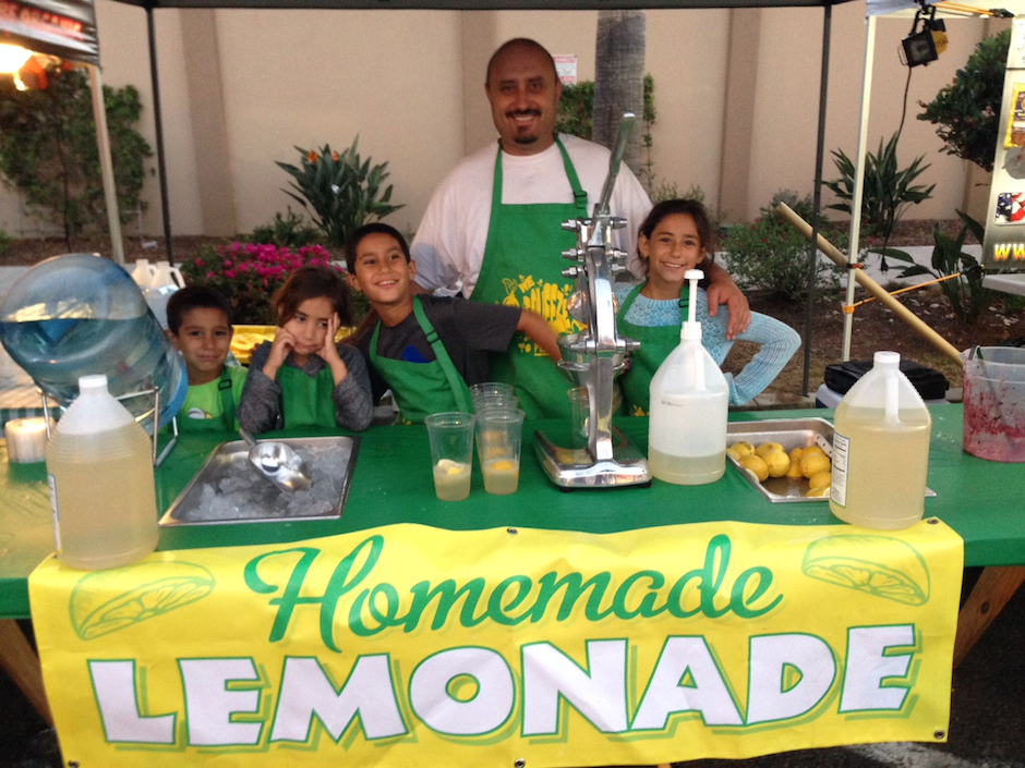 Aaron Miranda and four of his five kids at their lemonade stand in California.