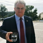 In this photo taken Thursday, Sept. 24, 2015, and provided by U.S. Rep. Bob Brady's office, Brady, D-Pa., holds a glass that Pope Francis used during his speech to Congress, while standing outside the U.S. Capitol in Washington. As Pope Francis left the chamber Thursday, Brady, who is Roman Catholic, headed to the lectern to retrieve the pontiff's drinking glass. (Stan White/U.S. Rep. Bob Brady's office via AP)