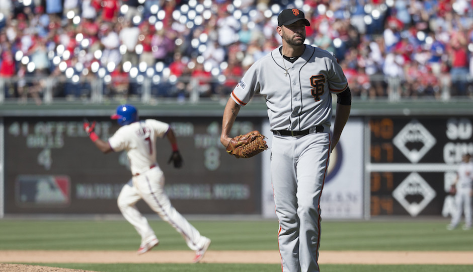 San Francisco Giants relief pitcher Jeremy Affeldt, right, looks for a new ball as Philadelphia Phillies' Maikel Franco, left, rounds the bases after hitting a solo home run during the eighth inning of a baseball game, Sunday, June 7, 2015, in Philadelphia. The Phillies won 6-4. (AP Photo/Chris Szagola)