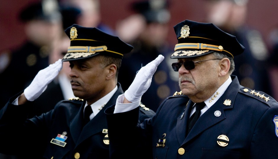 Police Commissioner Charles Ramsey, right, and his likely replacement, First Deputy Commissioner Richard Ross Jr., salute the family of slain Philadelphia Police Officer Robert Wilson III on Friday, March 13, 2015, in Philadelphia. (AP Photo/Matt Rourke)