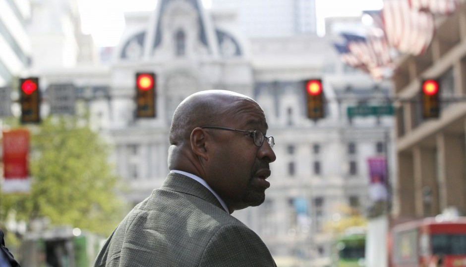 Philadelphia Mayor Michael Nutter walks down a blocked off Market Street, with City Hall in the background, in Philadelphia on Friday, Sept. 25, 2015, before Pope Francis' trip. (AP Photo/Mel Evans)