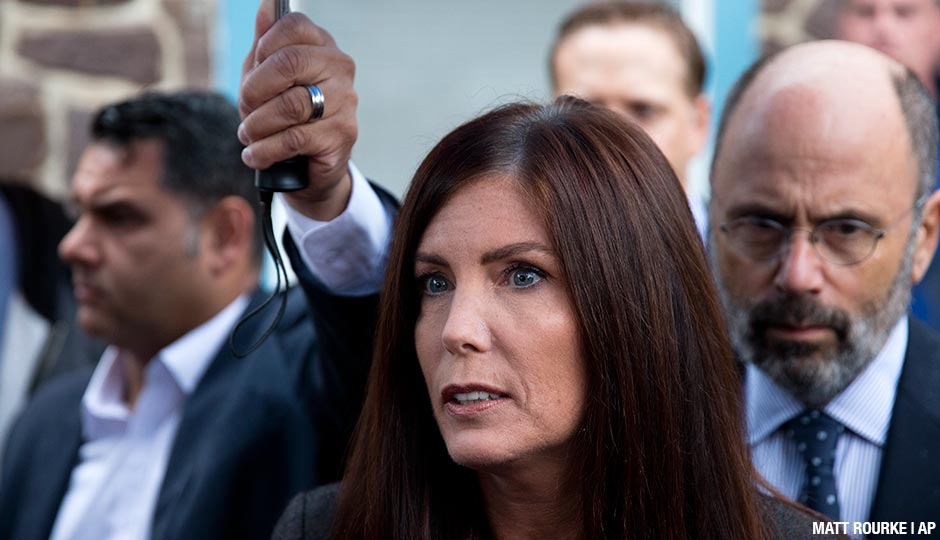 Pennsylvania Attorney General Kathleen Kane speaks with members of the media after her arrangement before a district judge, Thursday, Oct. 1, 2015, in Collegeville, Pa. Prosecutors added a new perjury count and other criminal charges Thursday against Kane, saying they found a signed document that contradicts her claims she never agreed to maintain secrecy of a grand jury investigation in 2009, before she took office. The Montgomery County district attorney charged her with felony perjury and two misdemeanors — false swearing and obstruction — based on a signed secrecy oath she signed shortly after taking office in early 2013.