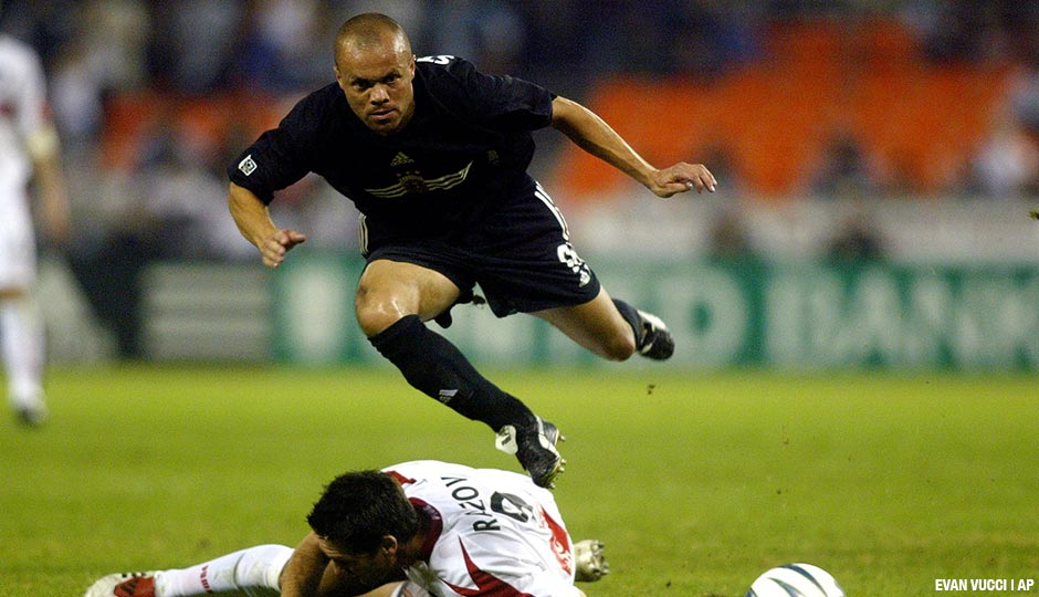 Earnie Stewart, then a midfielder for DC United, jumps over a slide tackle by Chicago Fire forward Ante Razov in the first half of a Saturday, November 1, 2003, game in Washington.