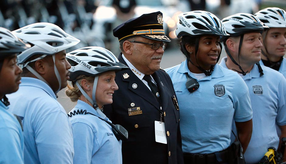 Philadelphia Police Commissioner Charles Ramsey poses with other police officers Saturday, Sept. 26, 2015, in Philadelphia. (AP Photo/Pablo Martinez Monsivais, Pool)