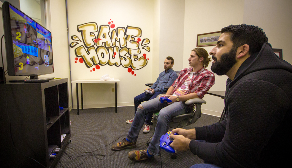 A video game break for employees at Fame House.