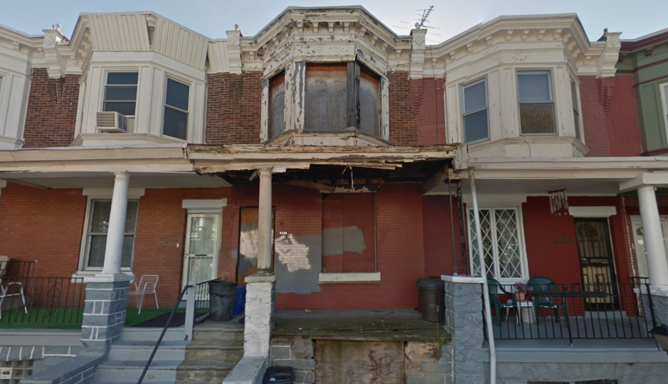 A blighted, vacant home lacking doors and windows on an otherwise healthy block in West Philadelphia. | Image: Google Streetview.