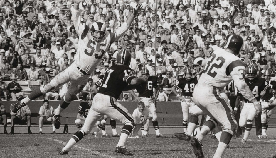 Maxie Baughan, playing for the Los Angeles Rams in 1968, pressures the quarterback. (Photo courtesy of USA Today Sports)